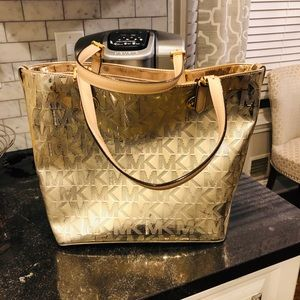 Michael Kors NWOT. Metallic  light gold tote